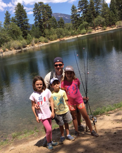 Partner Tom Barry fishing with his kids