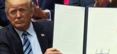 Donald Trump signing an executive order giving religious organizations the freedom to support political candidates